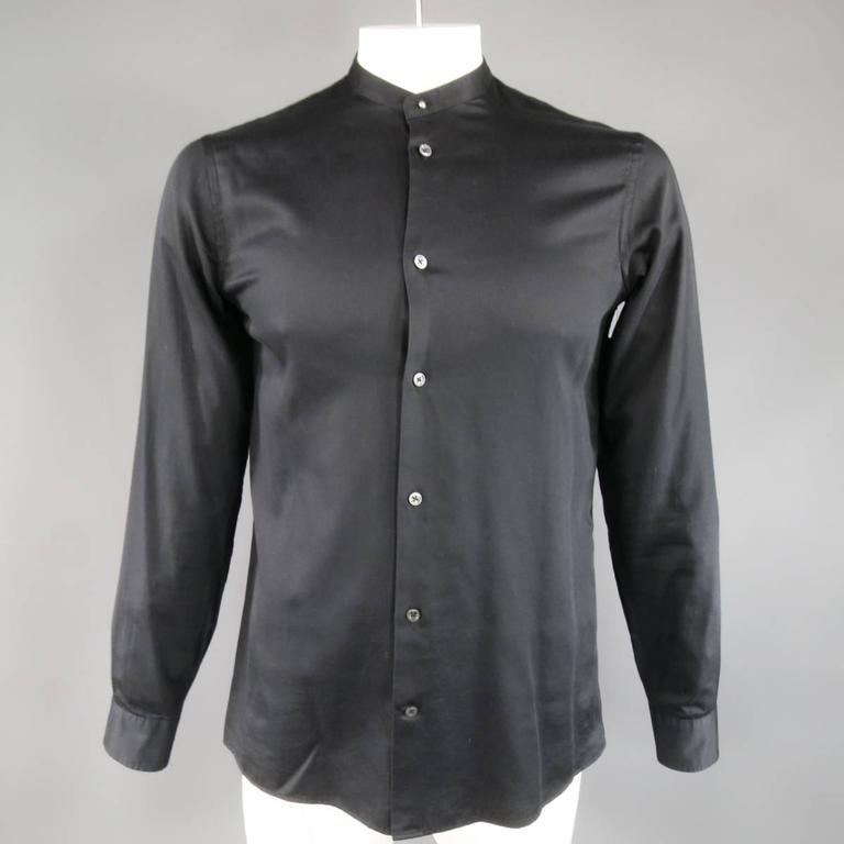 This classic MAISON MARTIN MARGIELA shirt comes in a light weight black cotton and features a detachable pointed collar with button stud, and signature white stitches at back. Made in Italy.   Excellent Pre-Owned Condition. Marked: IT 50