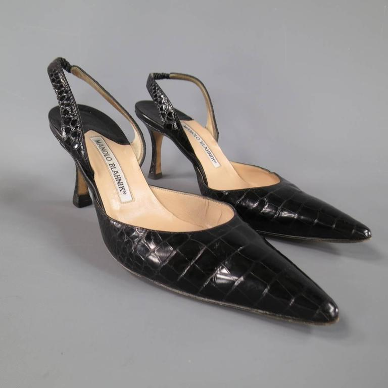 bcfc3138258 Classic MANOLO BLAHNIK slingback pumps in a black textured alligator skin  leather featuring a pointed toe