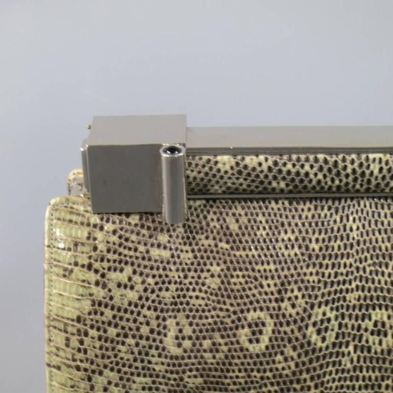 This gorgeous JUDITH LEIBER handbag comes in a light green snakeskin leather and features a structured shape, pleated side, and geometric silver tone metal clasp closure and includes a detachable shoulder strap, coin purse, and mirror. Wear on