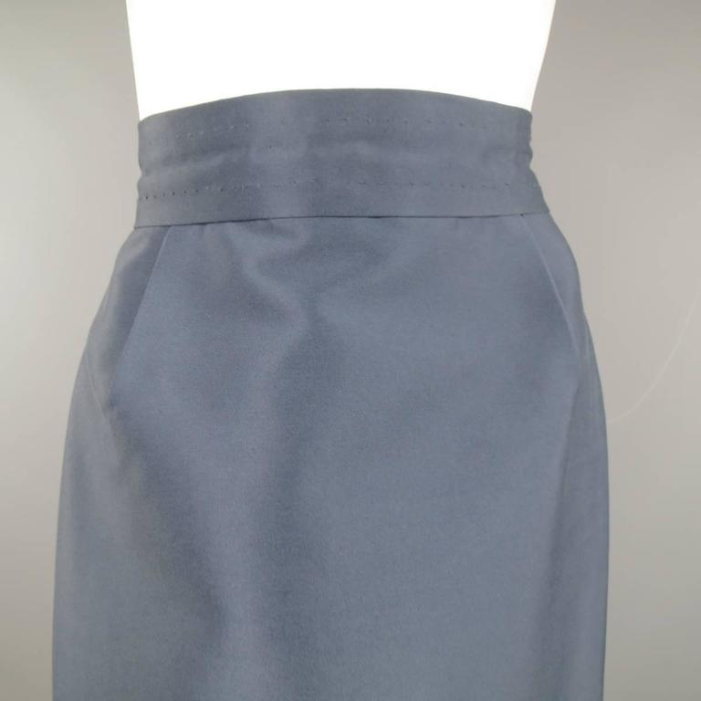 MARC JACOBS A-line skirt features a nylon/silk blend satin in a slate blue color. Fully lined with zip and hook and eye closure. Made in USA.   Excellent Pre-Owned Condition. Marked: 4   Measurements:   Waste: 28 In. Hip: 38 In. Length: 25 In.