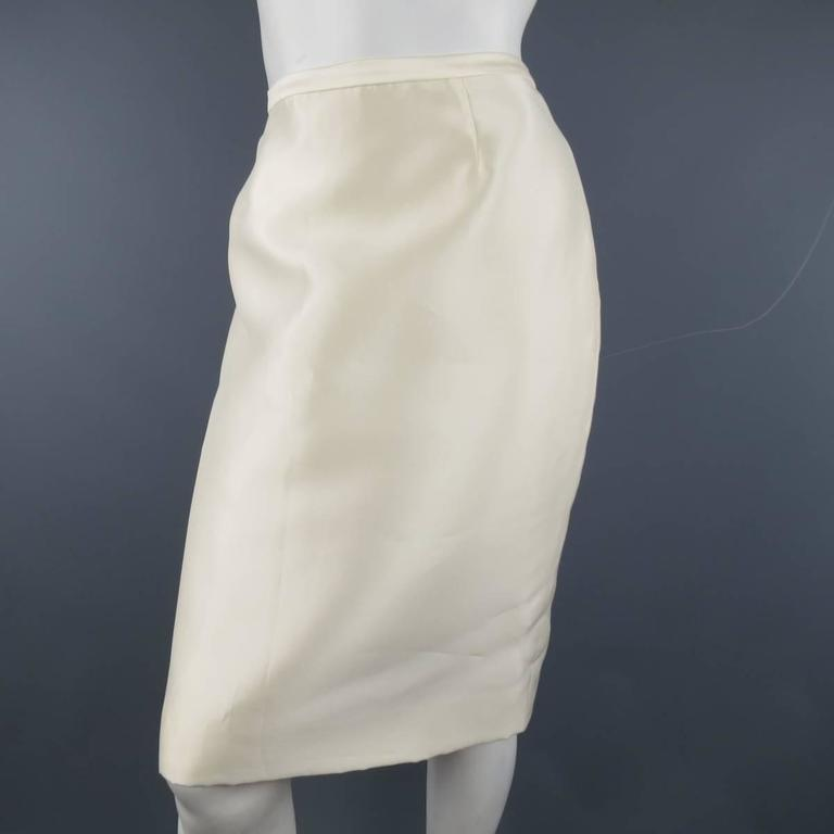 e69eb8f64 BADGLEY MISCHKA pencil skirt in a cream structured satin material with  hidden back zip closure.