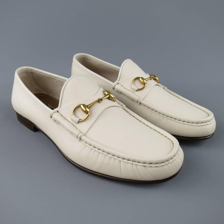 Classic GUCCI loafers in a light off white creamy beige matte leather with  yellow gold tone horsbit. With Box. Made in Italy.    New with Box. Retails at $790.00. Marked: 10.5