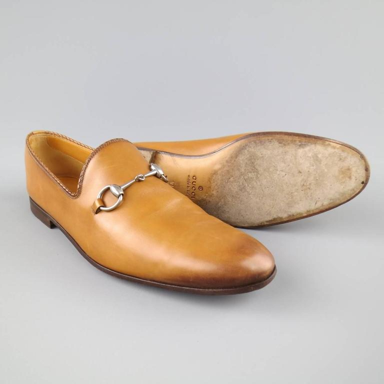 GUCCI loafers in a smooth tan leather featuring a brown ombre tip dye effect, braided piping, and silver tone horsebit detail. Wear throughout. With box  and shoe trees. Made in Italy.   Good Pre-Owned Condition. Marked: UK 10