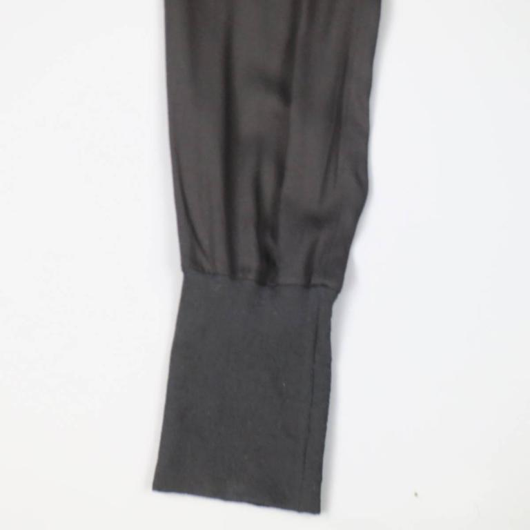 ANN DEMEULEMEESTER trousers ia light weight rayon jersey featuring slit pockets, mock fly, thick elastic cuffs, and a thick elastic silk satin waistband. Made in Portugal.   Excellent Pre-Owned Condition. Marked: 36   Measurements:   Waist: 24