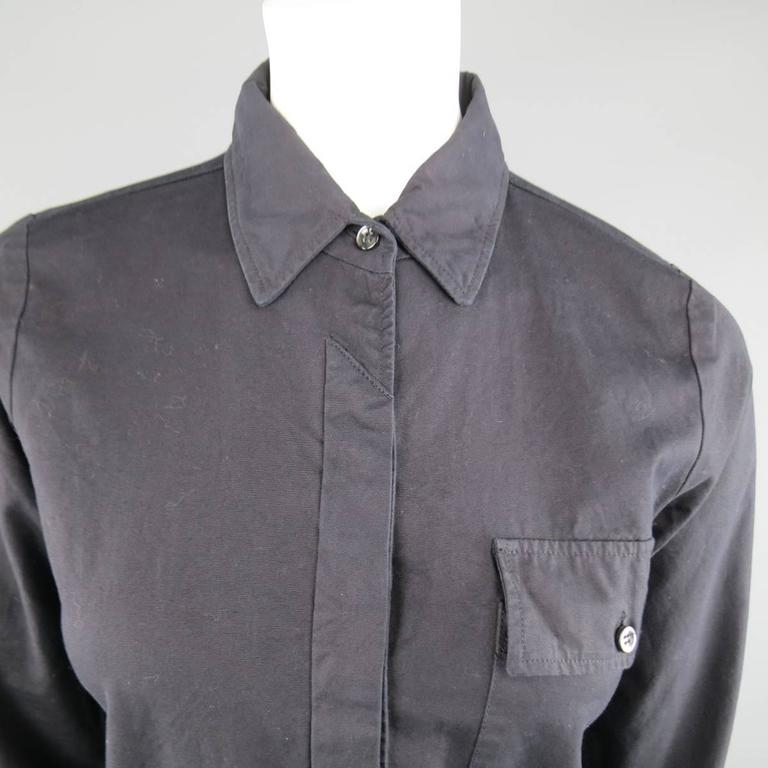 "Vintage MAISON MARTIN MARGIELA solid black cotton ""TIGHT FIT"" long sleeve shirt features hidden placket button closure, and breast pocket with button flap closure.   Excellent Pre-Owned Condition. Marked: 6   Measurements:   Shoulders: 13.5"