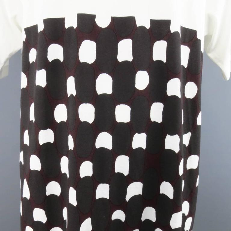 New MARNI short sleeve T-shirt in a white cotton featuring an extended hem and half color black with burgundy and charcoal abstract polka dot print. Made in Italy.   New with Tags. Marked: IT 50   Measurements:   Shoulder: 20 in. Chest: 48