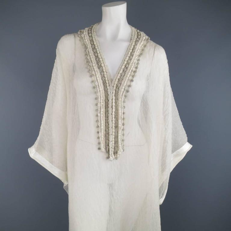 Gorgeous OSCAR DE LA RENTA kaftan style gown in a sheer, lace textured silk and features a v neckline with various embellished fringe trims. Faint discoloration at neckline. As-Is.   Good Pre-Owned Condition. One Size.   Measurements:   Width: 53