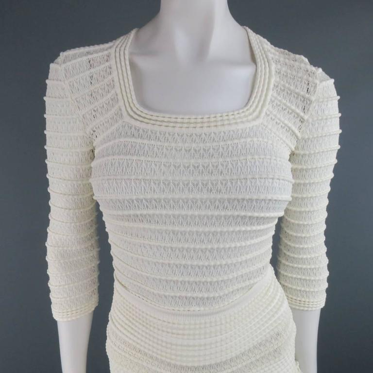 ALAIA skirt set in a creamy beige stripe textured viscose cotton mesh stretch knit includes a fitted, three quarter sleeve, scoop neck top and matching high rise, ruffled skirt. Made in Italy.   Excellent Pre-Owned Condition. Marked: Top M, Skirt
