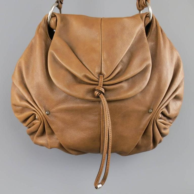 Vintage Fall 2003 YVES SAINT LAURENT by TOM FORD shoulder bag comes in a soft, textured, light brown leather and features a gathered flap snap closure, ruched side details with hardware, and shoulder strap with buckle. Wear throughout. As-Is. Made