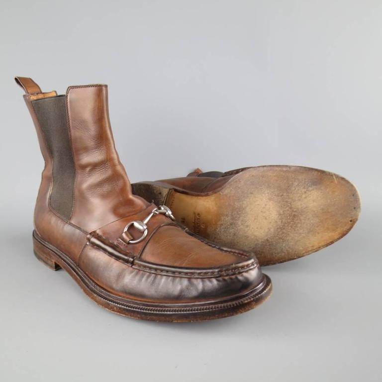 181f10092 GUCCI ankle boots in a distressed tan brown leather featuring a loafer top  stitch toe with