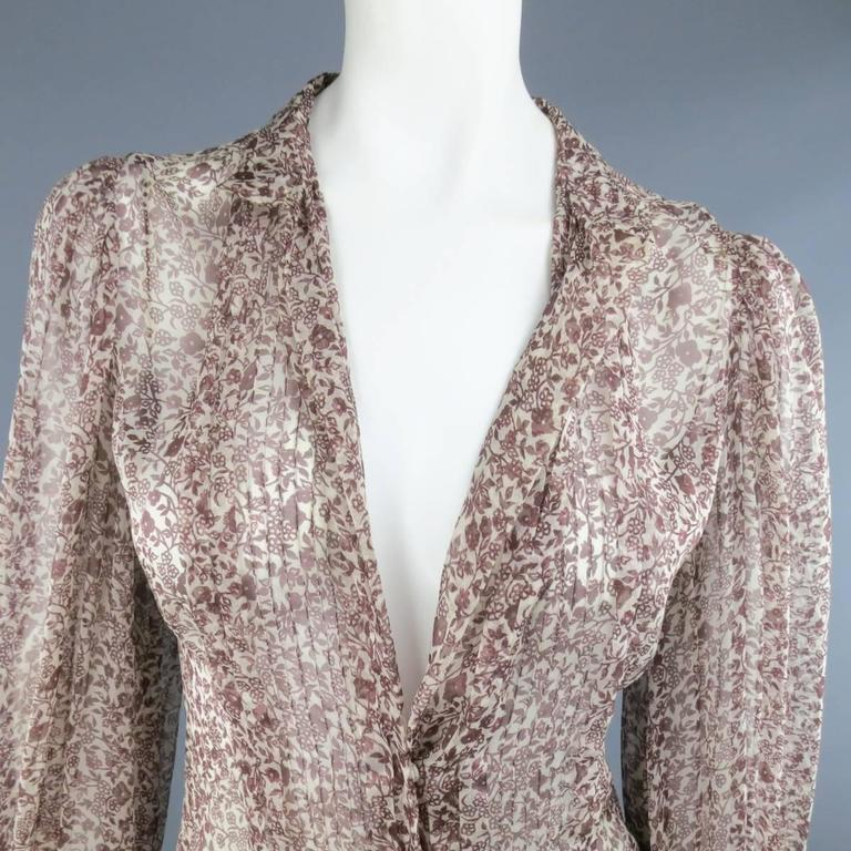 OSCAR DE LA RENTA Spring Summer 2006 Collection blouse in a brown and cream floral silk chiffon featuring a V neck with collar, snap closures, pleated chest panel, and brown and cream lace embroidered ruffle cuffs. Small hole on back shoulder.