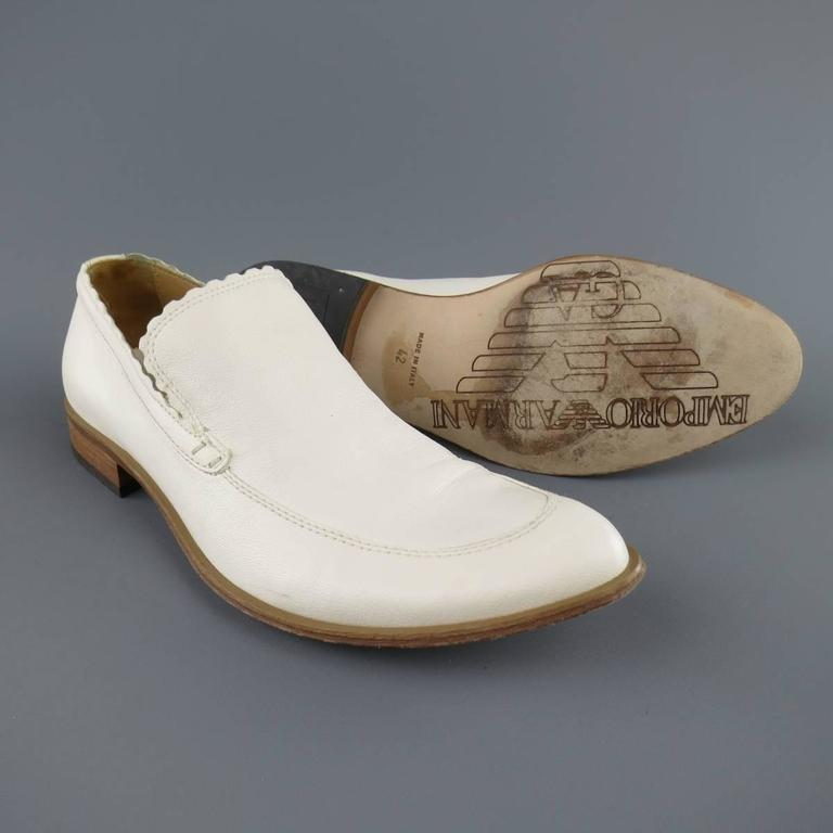 EMPORIO ARMANI loafers in an off white leather and features a pointed apron toe, tan sole, and scalloped edges. Marks throughout. With box. Made in Italy.   Good Pre-Owned Condition. Marked: 42   Outsole: 12.25 x 4.45 in.
