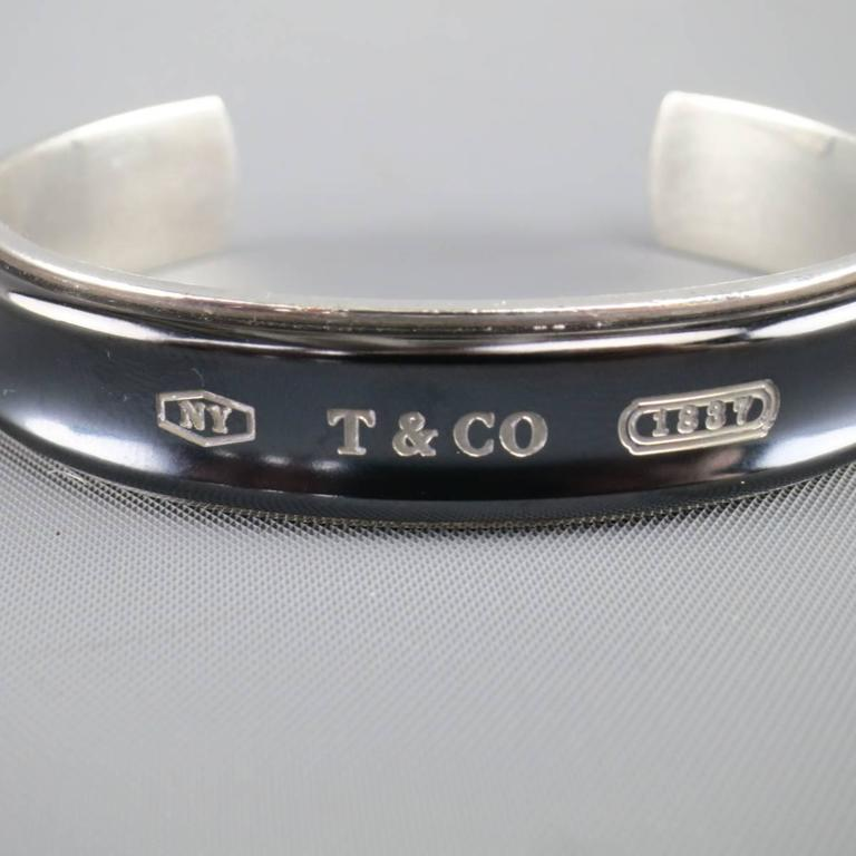 8752ac8e1 TIFFANY & CO. cuff bracelet in sterling silver featuring a midnight  titanium band with