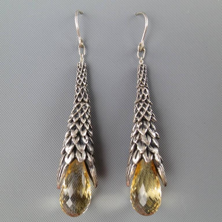 UGO CACCIATORI dangle earrings feature a leaf textured sterling silver drop with tear shaped smokey quartz crystal.   Excellent Pre-Owned Condition. Marked: 925   Length: 7 cm. Width: 1 cm.   Web ID: 82043