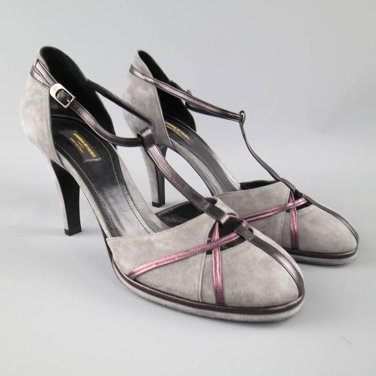 SONIA RYKIEL retro pumps come in gray suede and feature a round toe with metallic purple piping cutout details, covered heel, and black T strap. Made in Italy.   New without Tags. Marked: IT 40   Heel: 4 in.   Web ID: 77632