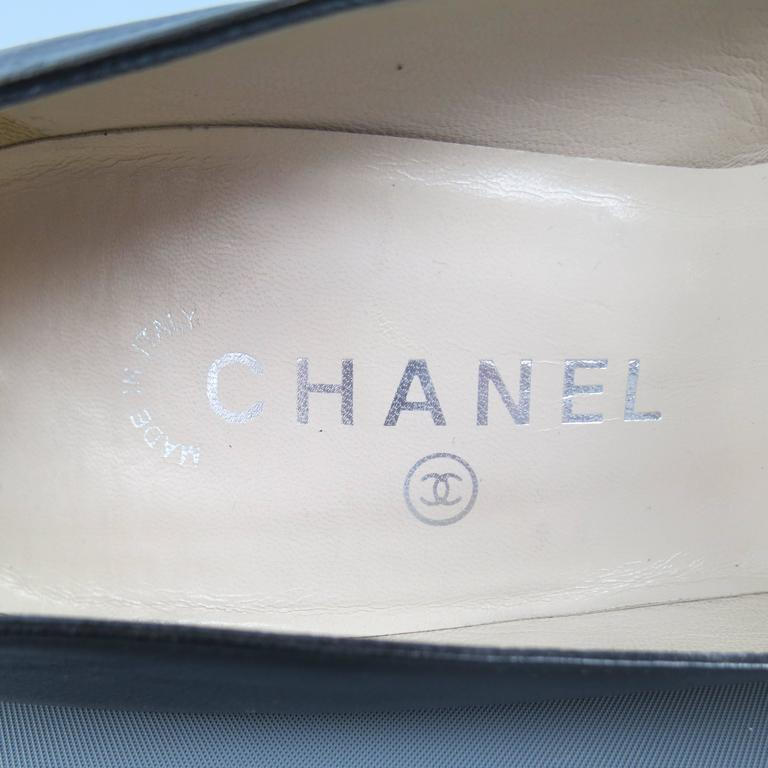 Vintage CHANEL Size 8.5 Black Leather Silver Logo Round Heel Pumps 7