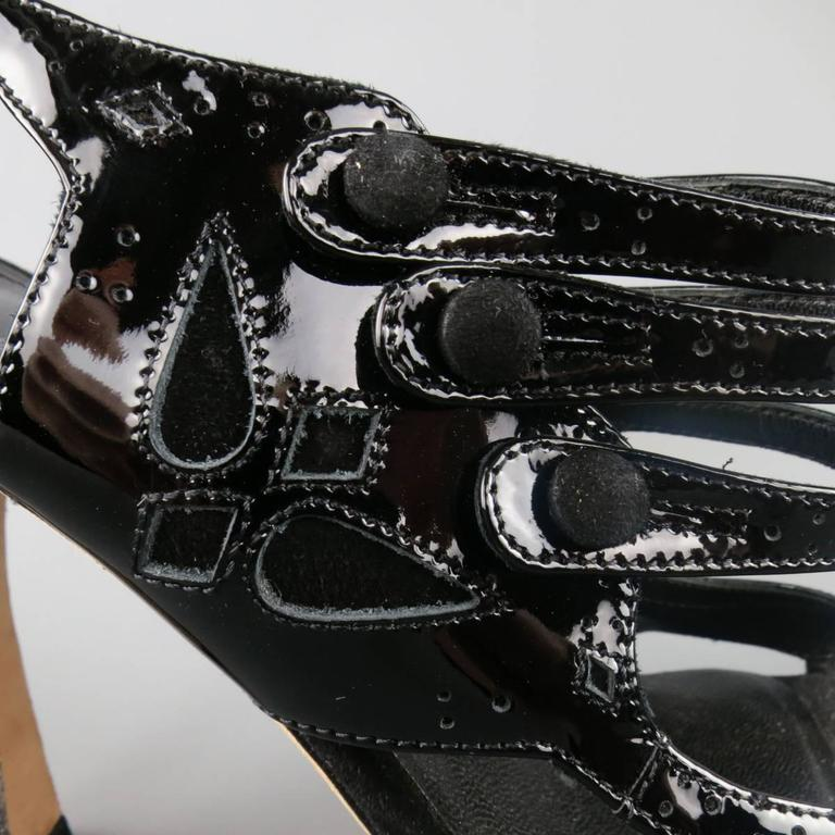 CHRISTIAN DIOR sandals in black patent leather featuring suede and brogue details throughout and stacked Mary Jane straps. Made in Italy.   Excellent Pre-Owned Condition. Marked: IT 41  Heel: 4 in. Web ID: 82294