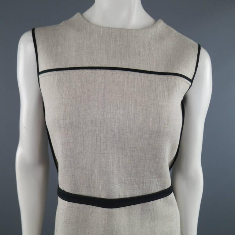 Sleeveless MARNI A line shift dress comes in a khaki beige bonded linen over wol and features a high neckline, black piping, and reverse finished seams throughout. Texture throughout. Made in Italy.   Excellent Pre-Owned Condition. Marked: IT 38