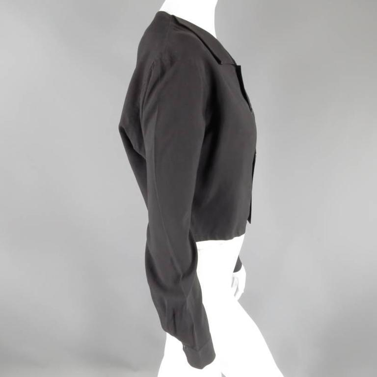 YOHJI YAMAMOTO ramie blouse is cropped, featuring mock abalone button fasteners, exaggerated collar,over-size blouson sleeves in neutral black. Made in France.   Excellent Pre-Owned Condition    Marked: Medium   Measurements:   Shoulder: 18