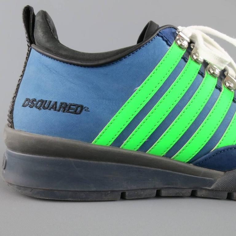 1060df23678 DSQUARED2 sneakers in a two tone navy blue nubuck leather and feature  silver tone ski hooks