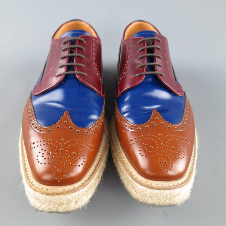 Iconic Spring Summer 2011 Collection PRADA brogues come in burgundy, navy blue, and tan color block leather and feature a wingtip, perforated brogue details, and thick braided espadrille sole.  With box. Made in Italy.   Excellent Pre-Owned