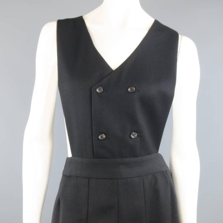 COMME des GARCONS SHIRT dress comes in a black wool twill and features a double breasted, V neck, bib vest top with box pleated A line skirt. Made in France.   Excellent Pre-Owned Condition. Marked: X   Measurements:   Shoulder: 13 in. Bust: 11.5