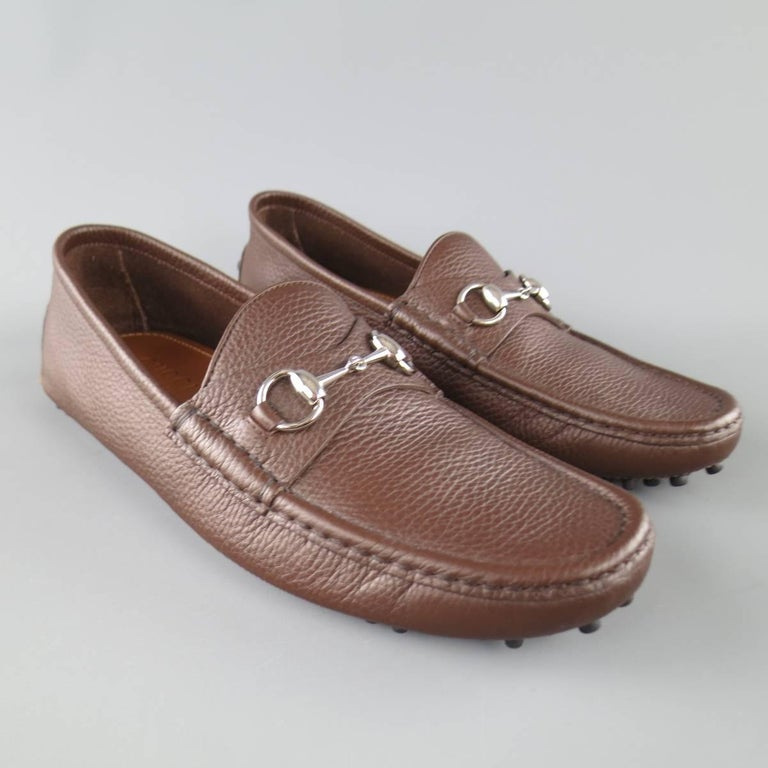 GUCCI loafers come in chocolate brown textured leather and feature a silver  tone horsebit detail and 1c0191be581a