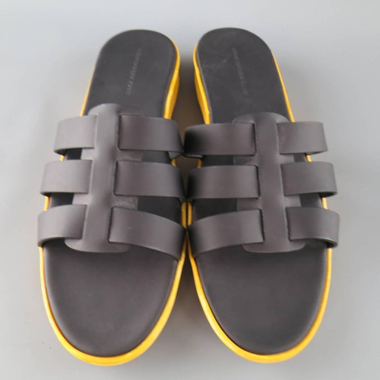 CHRISTOPHER KANE sandals feature black rubberized leather straps and a thick textured yellow rubber sole. Made in Italy.   Excellent Pre-Owned Condition. Marked: (no Size)   Outsole: 11.75 x 3.95 in.   Web ID: 82288