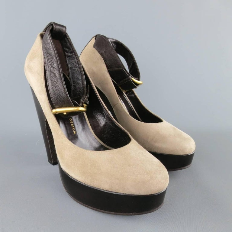 GIUSEPPE ZANOTTI pumps come in light taupe gray suede and feature a round toe, brown leather ankle strap with gold tone buckle, and thick, retro style platform sole. Made in Italy.   Excellent Pre-Owned Condition. Retails at $720.00. Marked: IT 39