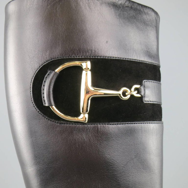 GUCCI vintage inspired knee high boots come in smooth black leather and feature a square toe, thick stacked heel, internal side zip, and suede detail with light gold tone  horsebit hardware. With Box. Made in Italy.   Excellent Pre-Owned