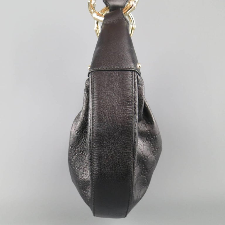 Gucci Black Monogram Embossed Leather Gold Bamboo Handle