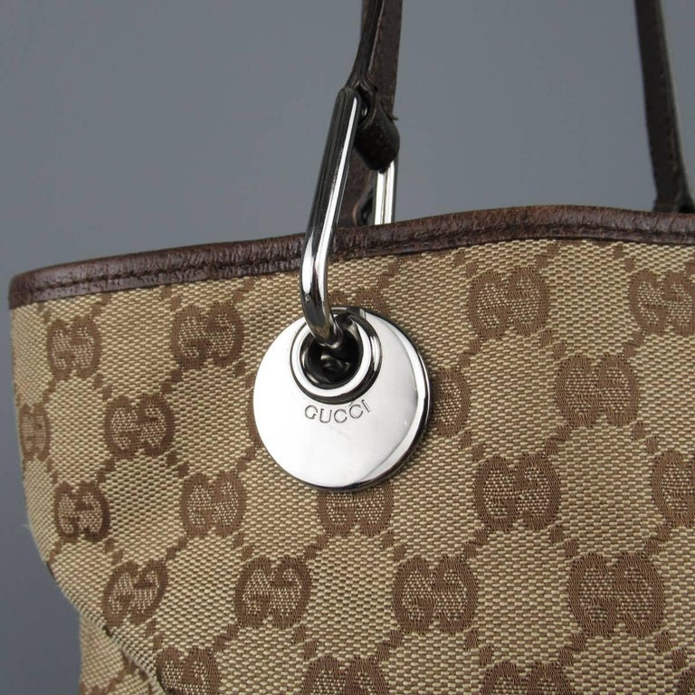 bbb491416644 ... Handle Mini Tote Bag For Sale. Classic GUCCI mini tote comes in beige  and brown Guccissima monogram canvas and features brown leather