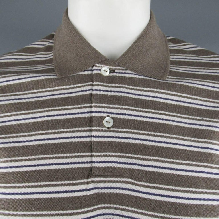 Classic LORO PIANA polo comes in taupe cotton pique with all over white & navy stripe pattern and contrast collar. Made in Italy.   New with Tags. Marked: XXL   Measurements:   Shoulder: 18 in. Chest: 48 in. Sleeve: 9.5 in. Length: 28 in.  SKU: 84036