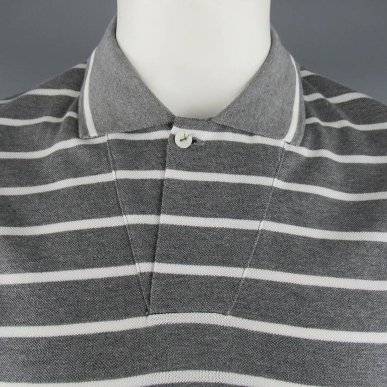 Classic LORO PIANA polo comes in dark heather gray & white stripe cotton pique with a diagonal seam single button closure. Made in Italy.   New with Tags. Marked: XXL   Measurements:   Shoulder: 20 in. Chest: 47 in. Sleeve: 9 in. Length: 29
