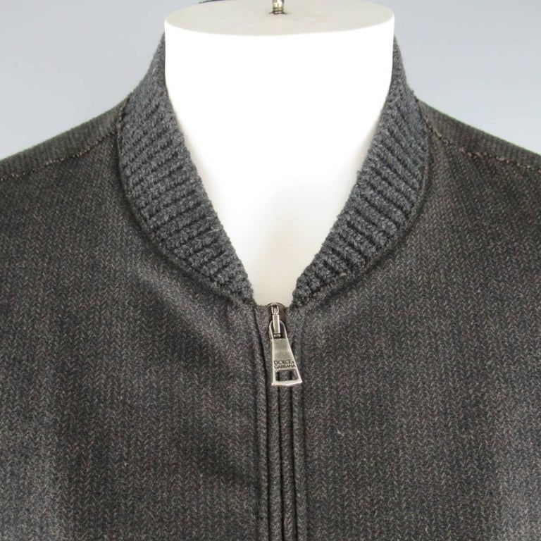 DOLCE & GABBANA bomber jacket comes in a charcoal and brown Herringbone wool blend flannel and features a knit ribbed baseball collar, slanted zip pockets, and raw edge details throughout. Made in Italy.   Good Pre-Owned Condition. Marked: IT