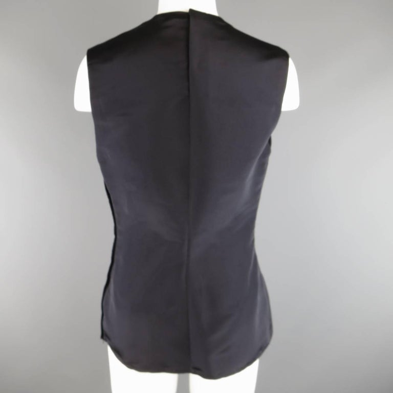Vintage 1980s GIANNI VERSACE Couture sleeveless shell blouse comes in a black silk tafeta with a high neckline and darted construction. Made in Italy.   Excellent Pre-Owned Condition. Marked: IT 42   Measurements:   Shoulder: 14.5 in. Bust: 38