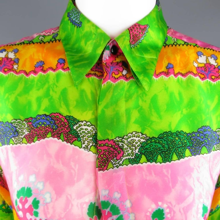 Vintage 1990's GIANNI VERSACE blouse comes in multi color silk with an all over abstract stripe print with hues of green, yellow gold, and pink featuring a pointed collar, oversized fit, and hidden placket closure. Made in Italy.   Excellent