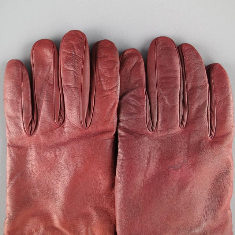 GIORGIO ARMANI gloves come in rich burgundy soft lambskin leather with embossed logo. Heavy wear throughout. includes tags. Made in Italy.   Fair Pre-Owned Condition. Marked: M   Length: 8.5 in. Width: 4.5 in.  SKU: 84641