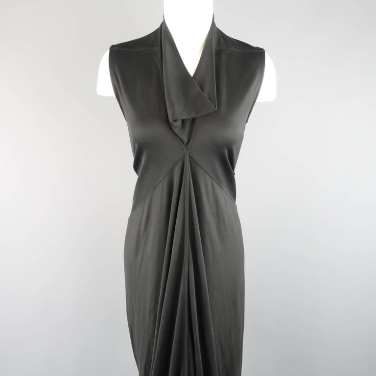 This fabulous RICK OWENS gown comes in a silk jersey knit and features a draped collar, gathered center, and long mermaid train. Made in Italy.   New with Tags. Retails: $2,905.00. Marked: US 8   Measurements:   Shoulder: 13.5 in. Bust: 38