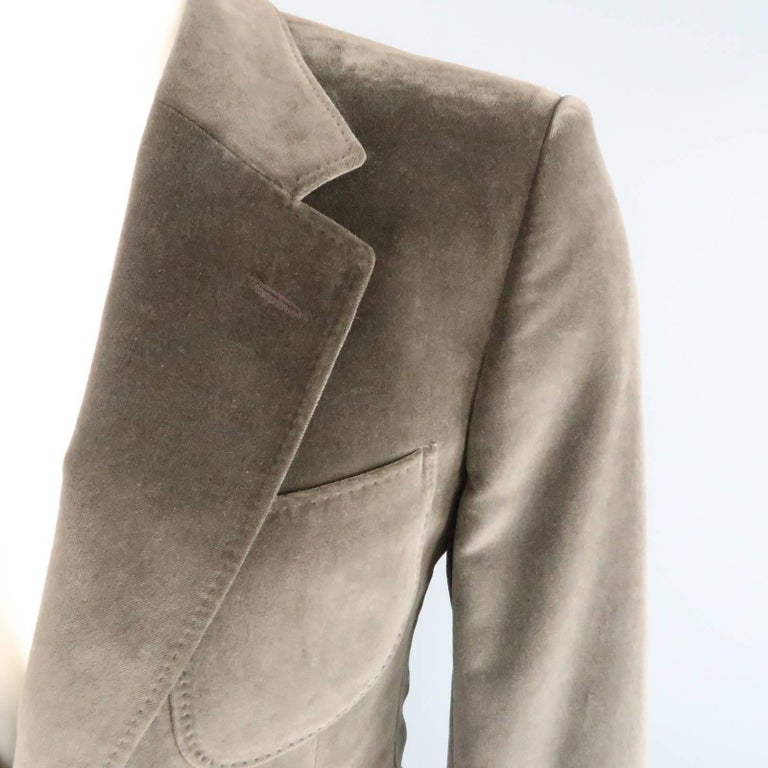 YVES SAINT LAURENT by TOM FORD sport coat comes in dark taupe velvet and features a notch lapel, triple patch pockets, unique tab button cuffs, and top stitching throughout. Snag on lapel. As-Is.   Good Pre-Owned Condition. Marked: 44 R