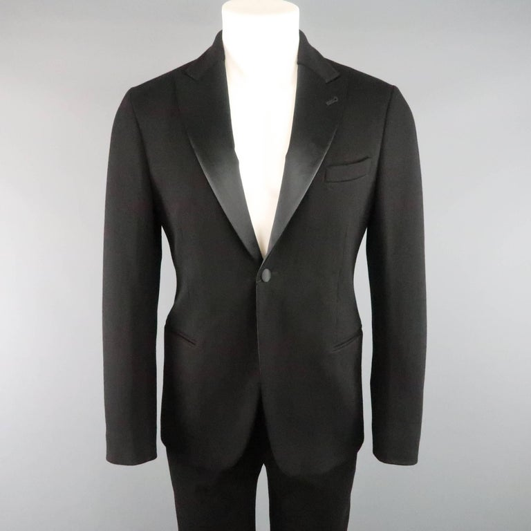 GIORGIO ARMANI tuxedo comes in a soft jersey material and includes a classic single button, satin lined, peak lapel jacket with faux slit pockets and matching satin stripe tuxedo pants. Made in Italy.   Retails: $3,195.00 New with Tags. Marked: IT