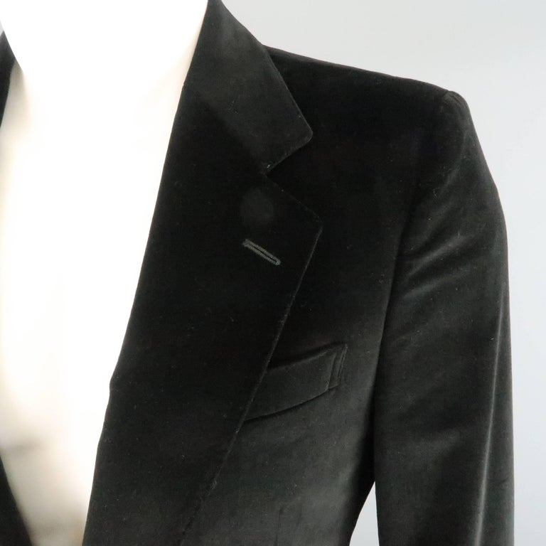 YVES SAINT LAURENT by TOM FORD sport coat comes in black cotton velvet and features a notch lapel with top stitching, two button closure, faux flap pockets, tab cuffs, and single vented back. Made in Italy.   Excellent Pre-Owned Condition. Marked: