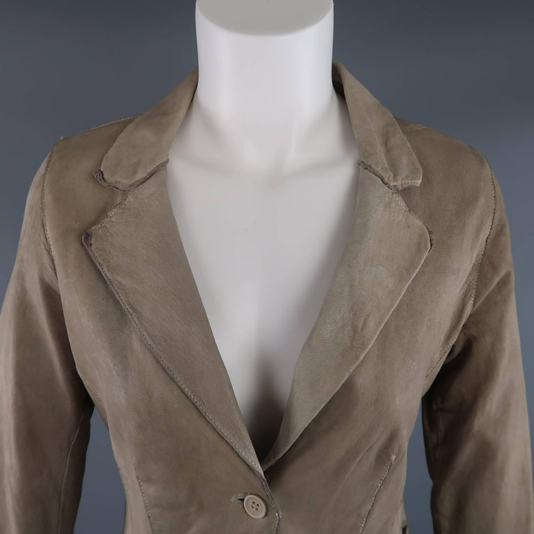 TRANSIT PAR-SUCK sport coat comes in a light washed taupe dyed distressed leather and features a notch lapel, two button closure, slip pockets, and extended crepe liner. Made in Italy.   Good Pre-Owned Condition. Marked: 2  Original Retail Price: