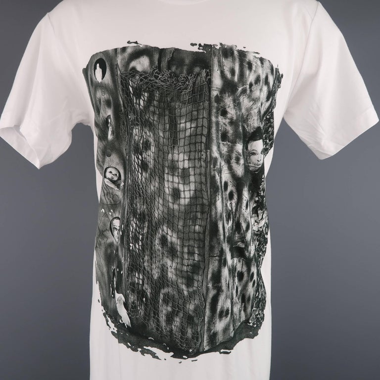 COMME des GARCONS short sleeved extended tall t-shirt comes in classic white cotton jersey and features a Roger Ballen graphic print and diagonal seam construction. Made in Japan.   New with Tags. Marked: M   Measurements:   Shoulder: 20 in. Chest: