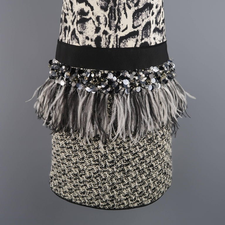 This gorgeous Giambattista Valli mixed material sheath cocktail dress features a snow leopard print silk top panel with round neck and bow, faille drop waistband with sequin beading and ostrich feather trim, and tweed skirt. Autumn/Winter 2013
