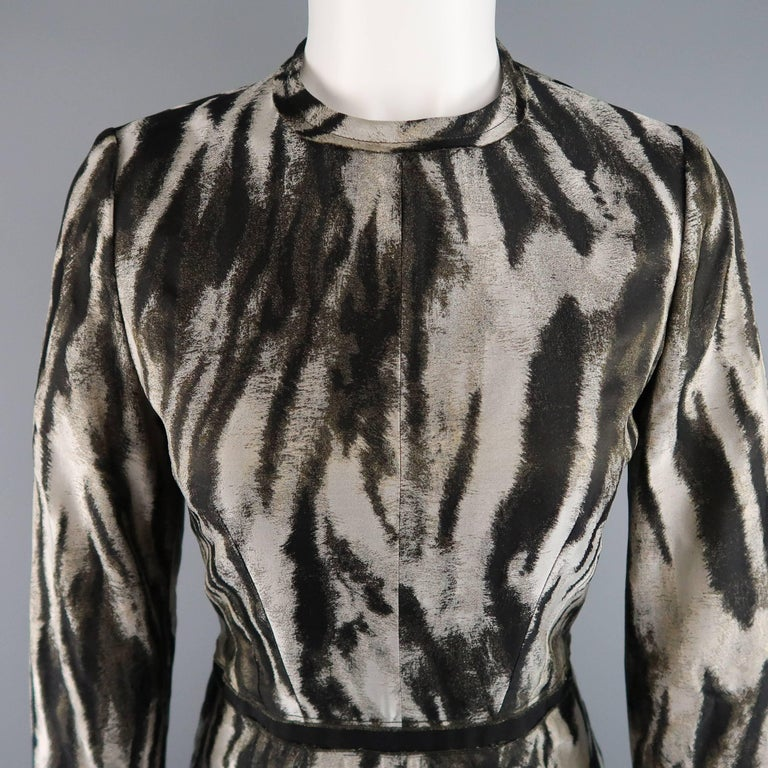 LANVIN Fall 2013 cocktail dress comes in a silver animal print silk blend fabric and features a round neckline, faille ribbon waistband, long sleeves with ruffled zip cuff, and fitted skirt with ruffled hem. Made in France.   Excellent Pre-Owned