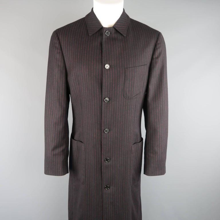Archive ROMEO GIGLI coat comes in black and red pinstripe wool and features a classic pointed collar, six button front, patch pockets, button cuffs, and an extended, full length hemline.   Excellent Pre-Owned Condition. Marked: IT 48