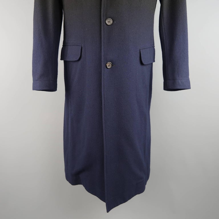 Archive ISSEY MIYAKE overcoat comes in a black wool blend and features a notch lapel, three button front, flap pockets, and overall navy blue ombre gradient effect throughout. Includes original tag. Made in Japan.   Good Pre-Owned Condition. Marked:
