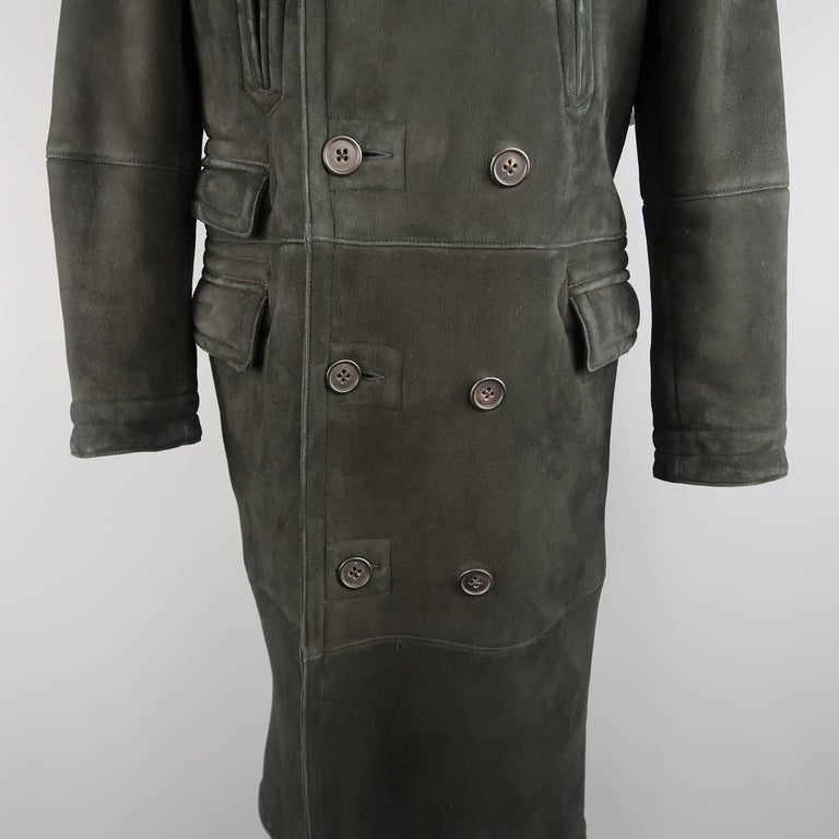 This full length POLO RALPH LAUREN pea coat comes in black Italian shearling and features a pointed fur lapel, double breasted button up front, slanted slit pockets, triple flap pockets, and full shearling fur interior. Wear throughout. As-Is.