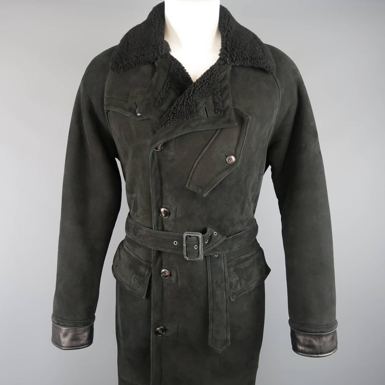 POLO RALPH LAUREN overcoat comes in black Italian Shearling and features a large pointed fur collar, double breasted button front, double flap pockets, slanted chest pocket, storm flap, leather cuffs, fulll fur lining, and belted waist. Wear